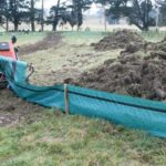 Silt fence installer in action